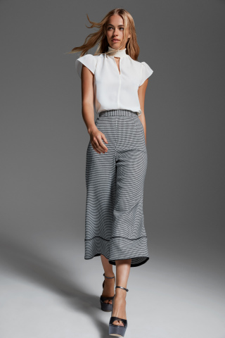 A staple of the Zoe by Rachel Zoe collection is the juxtaposition of feminine pieces with structured designs that offer women the freedom to mix up their everyday look, catering to the power woman looking for effortless and versatile fashion. The Zoe by Rachel Zoe collection, priced from $89 to $169, is available now on macys.com and in select Macy's stores beginning August 15. (Photo: Business Wire)